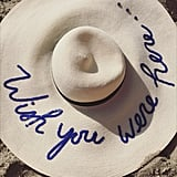 """Her Floppy Sun Hat Said, """"Wish You Were Here . . ."""""""