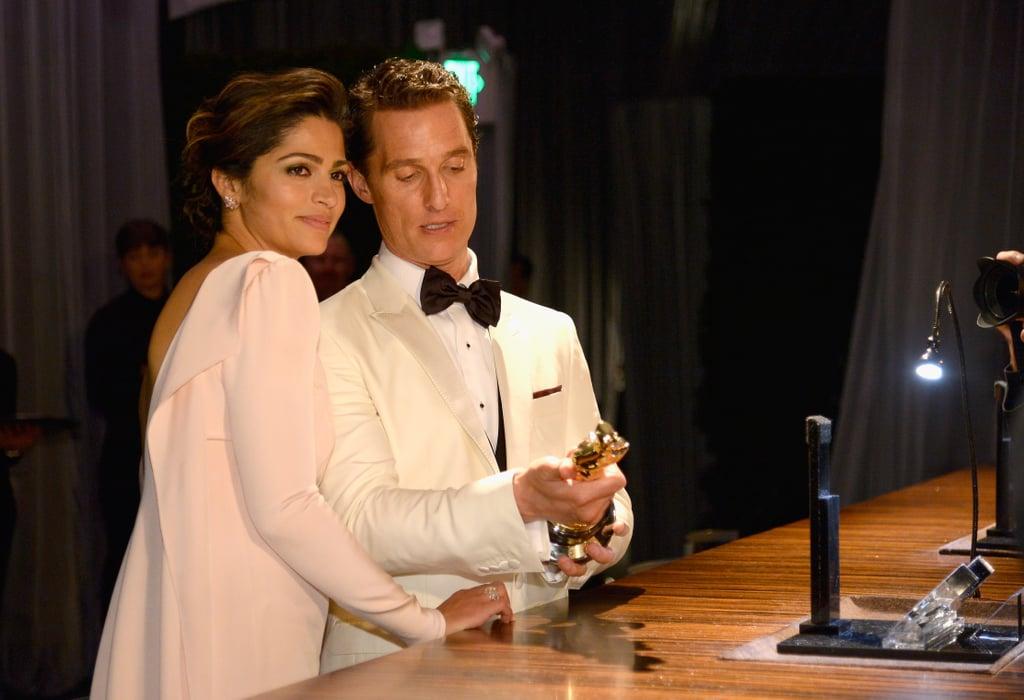 Matthew McConaughey and Camila Alves inspected his Oscar.