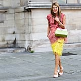 Anna Dello Russo ruled the sidewalk in multicolored feathers.