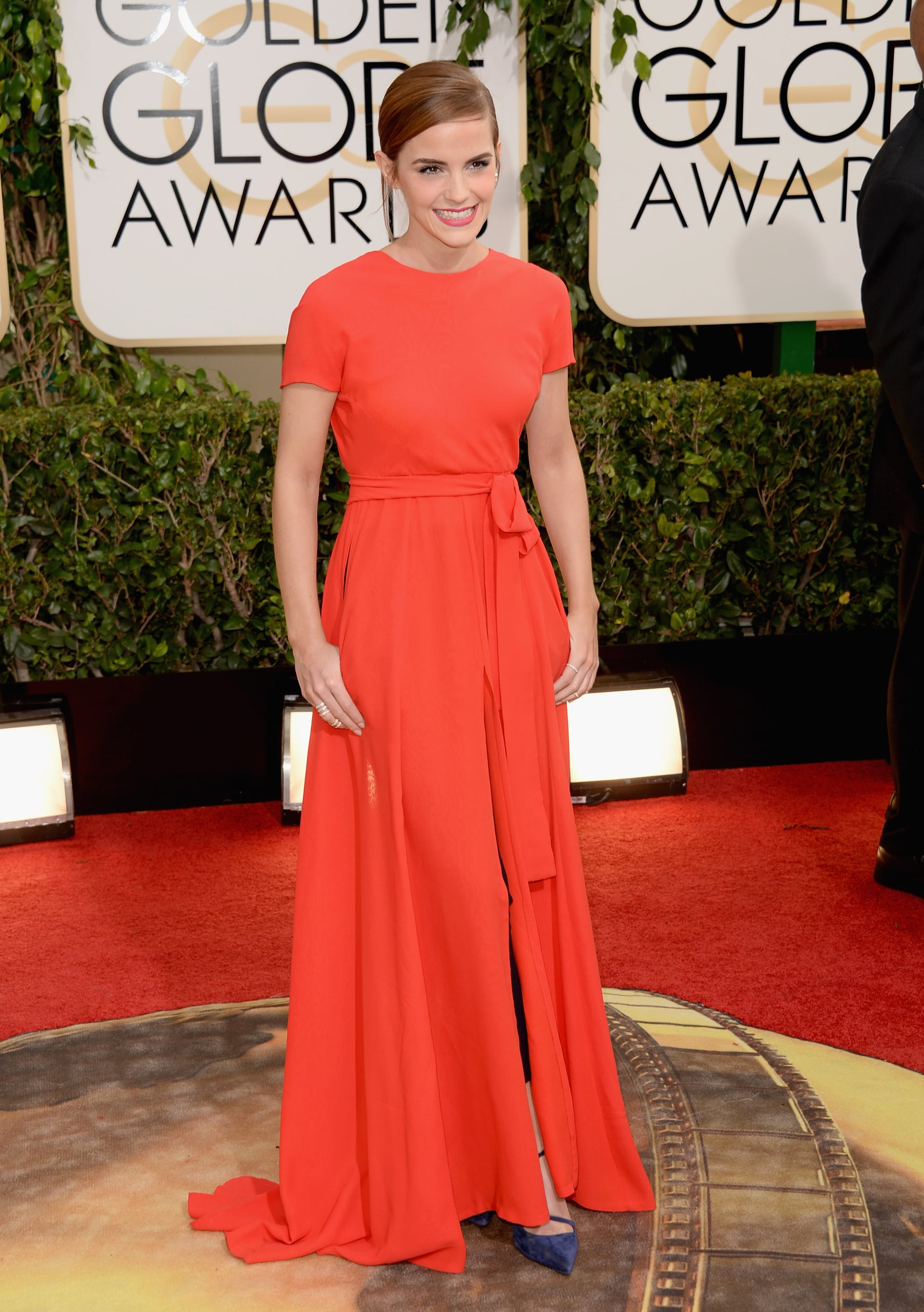 Emma Watson shined in a red dress with black pants underneath.