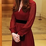 At the unveiling of her first portrait, Kate selected a deep-red Whistles dress for $133. She had previously worn it for a trip to Copenhagen and later on an engagement to Newcastle.