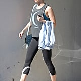 Emily Blunt rocking blue Nike sneakers as she heads to the gym with her hubby, John Krasinski.
