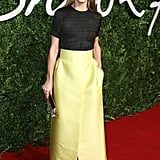 Olivia paired a textured top with a bold yellow skirt for an unexpected red carpet pairing that just works.