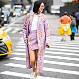 A Summery way to style prints head-to-toe is with a coordinating miniskirt and duster coat.