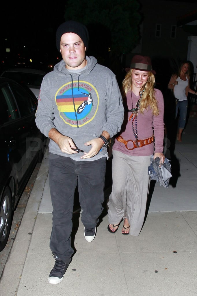 """A newly revealed as pregnant Hilary Duff and her husband, Mike Comrie, double dated with her sister, Haylie, and boyfriend Nick Zano at LA's Sushi Yuzu last night. It was a momentous weekend for Hilary, who announced her pregnancy on the eve of her first anniversary with Mike. It was just 12 months ago when Hilary walked down the aisle wearing a Vera Wang gown in front of 100 of their loved ones, and now the couple are preparing to tackle a new chapter together. Last month Hilary and Mike got a jump on their anniversary celebrations with a bikini-filled getaway to Italy. It's been an exciting 24 hours for the parents-to-be, and Hilary reached out to fans over Twitter thanking them for the outpouring of support and love, saying, """"Wow! I am just overwhelmed by all of the wonderful messages everyone is sending! Thank you so much! Big hugs! Xxo."""""""
