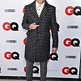 Macklemore wore a patterned coat to the GQ party on Friday.