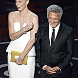 Charlize Theron laughed with Dustin Hoffman at the 2013 Oscars.
