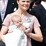 Crown Princess Victoria Holds Princess Estelle at Her Christening