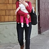 Drew Barrymore cradled Olive Kopelman in her arms.