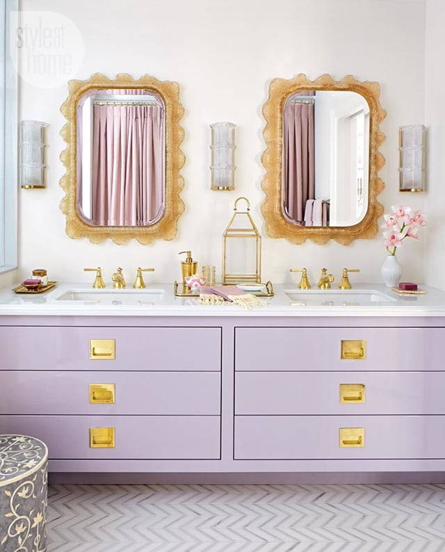 The purple and gold of this bathroom match her family's royal sigil.