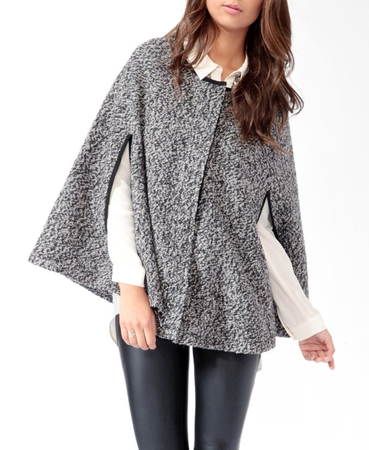 Keep it sleek, even as you pile on the layers, with a bouclé-textured cape. This contrasted version from Forever 21 ($38) definitely won't break the bank.