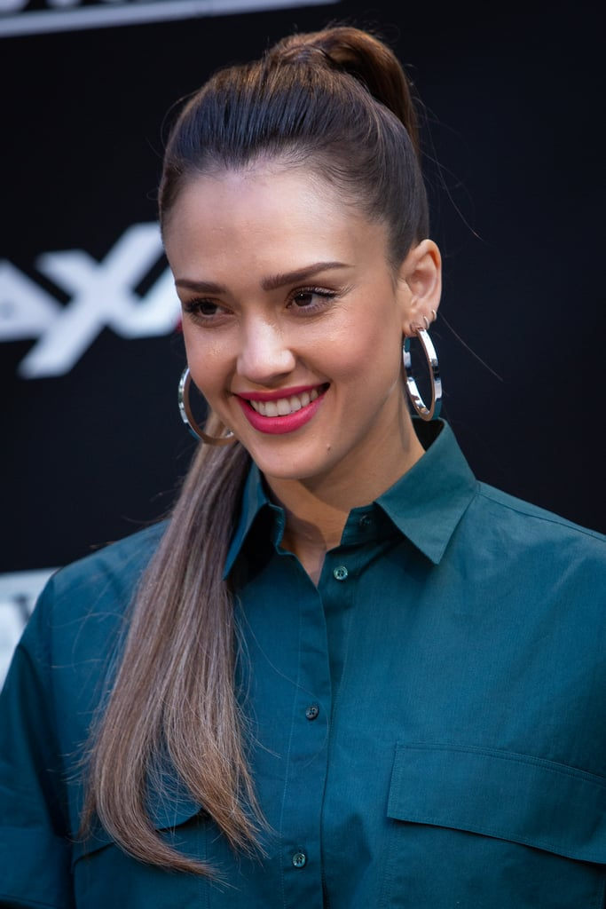 Jessica Alba just tried out the superlong hair trend and it has us wondering: Why did it take her so long??? The LA's Finest actor is on a European tour with best bud and co-star Gabrielle Union in Madrid, Spain. For the occasion, hairstylist Jesus Guerrero pulled out the big guns — i.e. incredibly long hair. And by long, we mean all the way down to her hips.   Alba's a woman of many talents. One being the ability to pull off any hairstyle she tries. Whether she's dabbling with an asymmetrical bobs, short bangs, and tousled waves back in 2002, she wears them all with ease. One thing she's always kept the same, however, is her brunette hair colour — until now. Not only was her hair as long as can be, but it also faded into a lighter, almost blonde hue, a perfect dye-job for the Summer months.  Hollywood has been obsessed with superlong hair for months now. Kim Kardashian loves the trend, taking cues from her fashion icon, Cher. Kardashian's sister Kylie also jumped on the Rapunzel hair bandwagon back in April with hair that practically touched the floor. And we can't forget Nicki Minaj, who spearheaded the trend and may just win top spot for longest hair on the red carpet, well, ever.  Read on to see Alba's superlong hair and how she styled it in a ponytail, too.