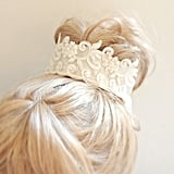 Fans of Downton Abbey will love this beautiful lace bun wrap ($39) with ivory pearls sewn on. The wrap works with or without a veil as the bow would hide the veil comb.