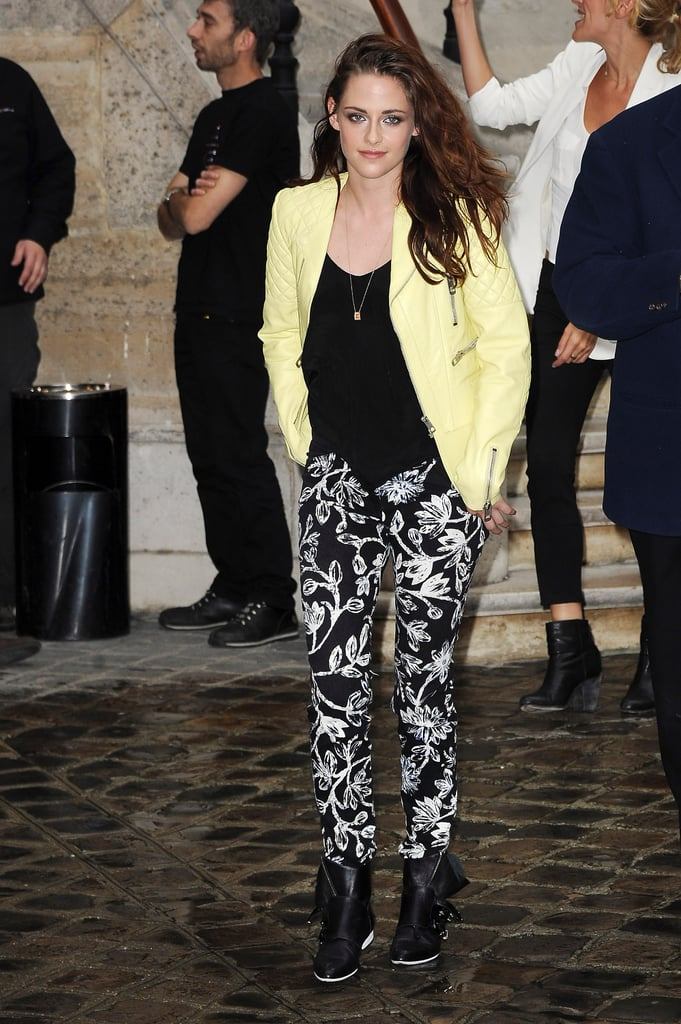 Kristen Stewart turned up the cool on this laid-back ensemble at Balenciaga at Paris Fashion Week, pairing a pastel moto jacket with printed trousers. She finished the look with a tough pair of buckled ankle boots.