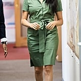 Meghan, Duchess of Sussex Wears A Green Shirtdress and Black Pointed Toe Pumps