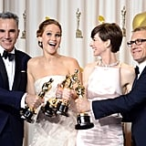Daniel Day-Lewis, Jennifer Lawrence, Anne Hathaway, and Christoph Waltz celebrated their Oscar wins in the press room.