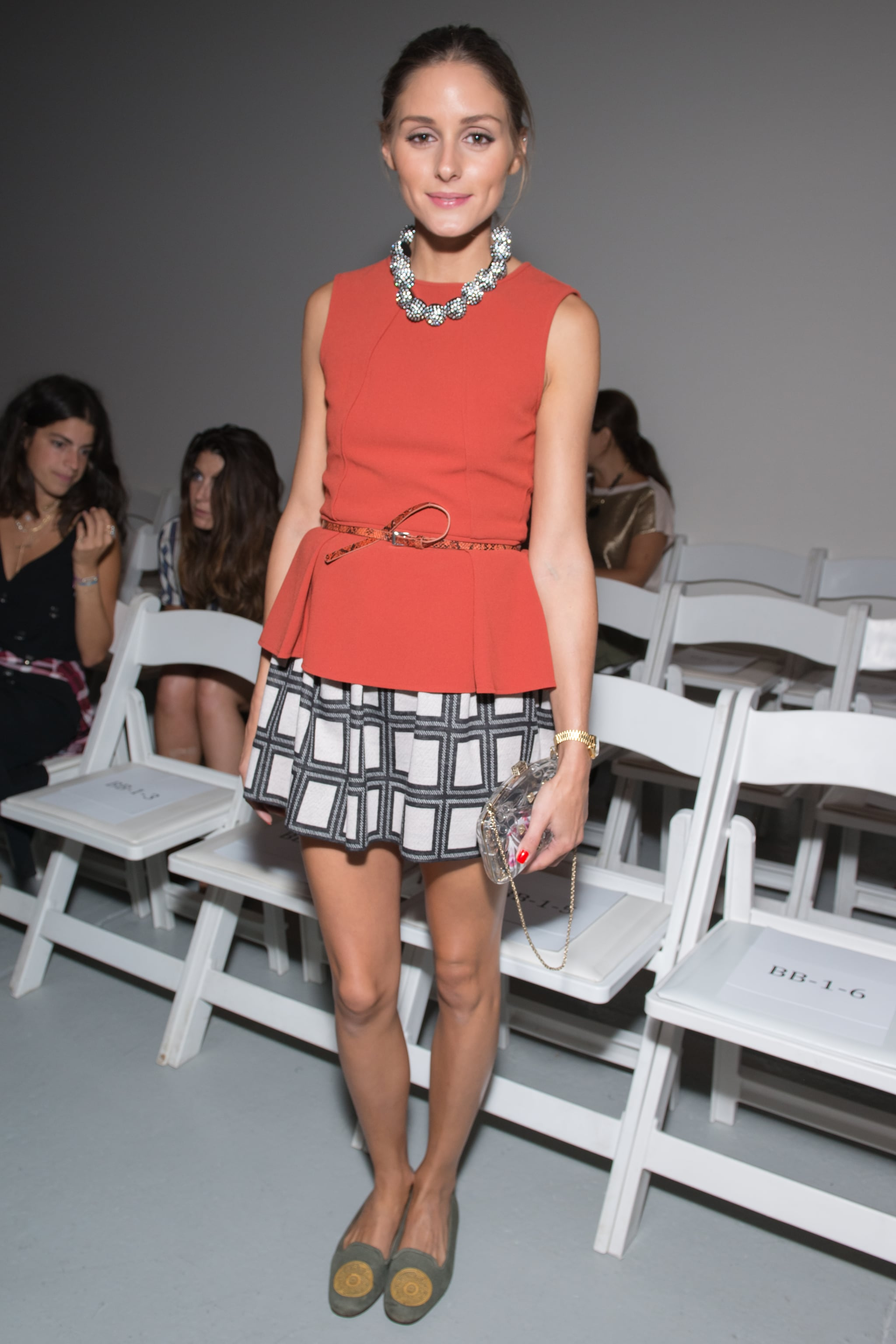 Olivia Palermo played up her red peplum top with a wide checkered skirt and embellished flat loafers at Tibi's Spring 2013 show in NYC.