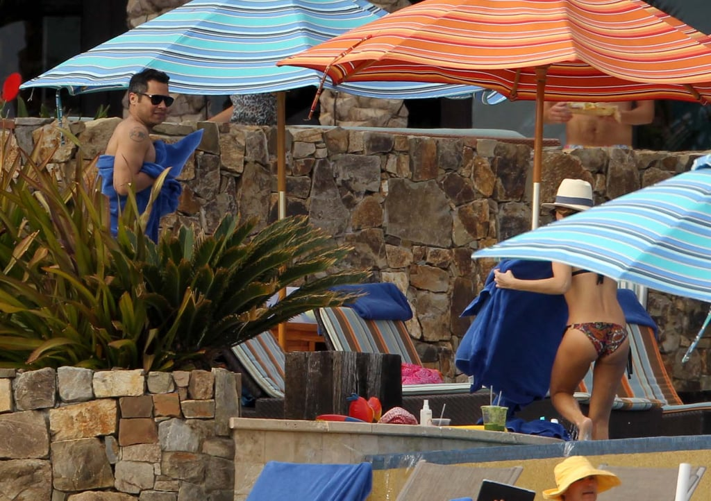 Cash Warren looked on as Jessica Alba exited a pool.