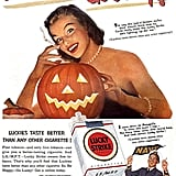 Another lady lights up with her pumpkin (who's apparently enjoying her ciggy). Who knew jack-o'-lanterns doubled as party lighters back in the day?