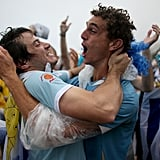Uruguay fans celebrated after the team scored its first goal against England.