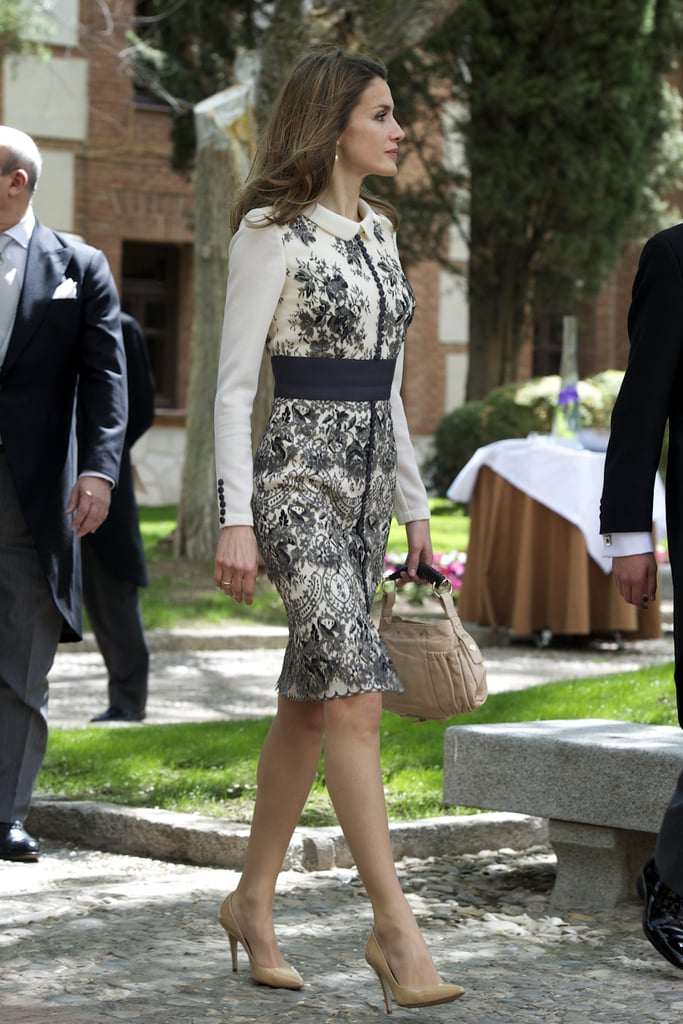 We love the feminine detailing on Letizia's lace-print, cream-colored shift.