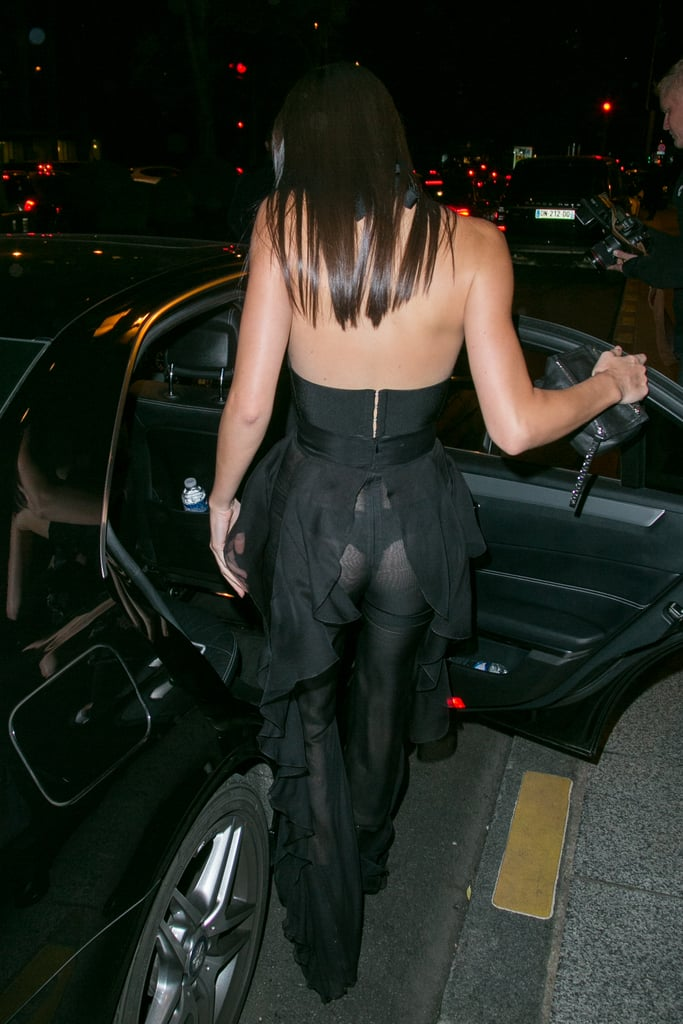 Kendall showed off the back of her ruffle-finished ensemble, boldly revealing her underthings!