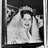 Margaret, who was 29 at the time, famously rode from Clarence House to the Abbey with her brother-in-law, Prince Philip. The Duke of Edinburgh walked Margaret down the aisle and gave her away at the altar. She wore a silk organza dress by Norman Hartnell, who also designed the queen's gown 13 years earlier.