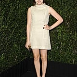 Chloë Moretz showed off her stems in a high-necked Chanel cream tweed dress, which also featured pearl buttons down the front.
