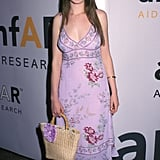 Fresh-faced in florals at amFAR in June 2002.