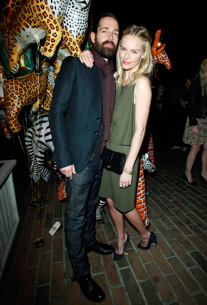 Kate Bosworth and boyfriend Michael Polish posed together on their way into a Mulberry dinner at Chateau Marmont in LA last night. Kate was head to toe in pieces from the luxury brand, including their army green dress and Harriet handbag. Kate and Michael laughed and smiled big as they headed inside, where they kept close while mingling with other guests. The couple split up earlier this week so that Kate could attend a Hollywood Reporter breakfast celebrating Women in Entertainment. She actually wore another look from Mulberry, which she accessorized with gems from her JewelMint line, at the event.