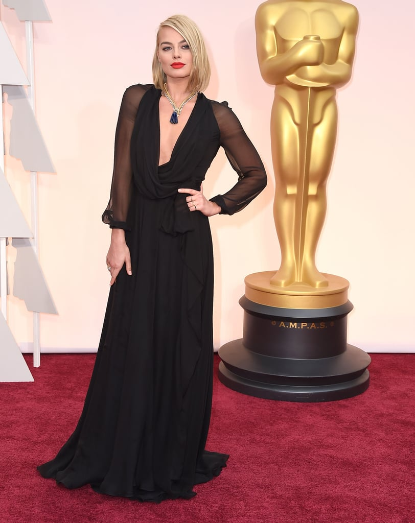 Wearing a Saint Laurent gown and Van Cleef & Arpels jewels to the Oscars in 2015.