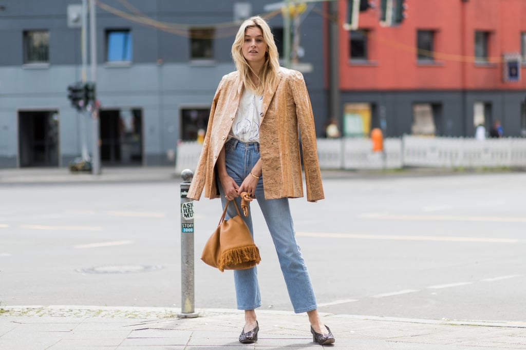 With a tailored jacket and smart flats for every day