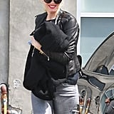 Gwen Stefani wore a plaid cap and bright red lips to a music studio in Santa Monica.