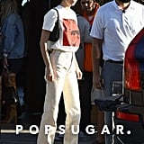 Kendall wore a pair of Martine Rose straight leg jeans with her Adidas Forum sneakers while out in LA. Up top, she opted for a Calvin Klein Andy Warhol tee and a Prada purse.