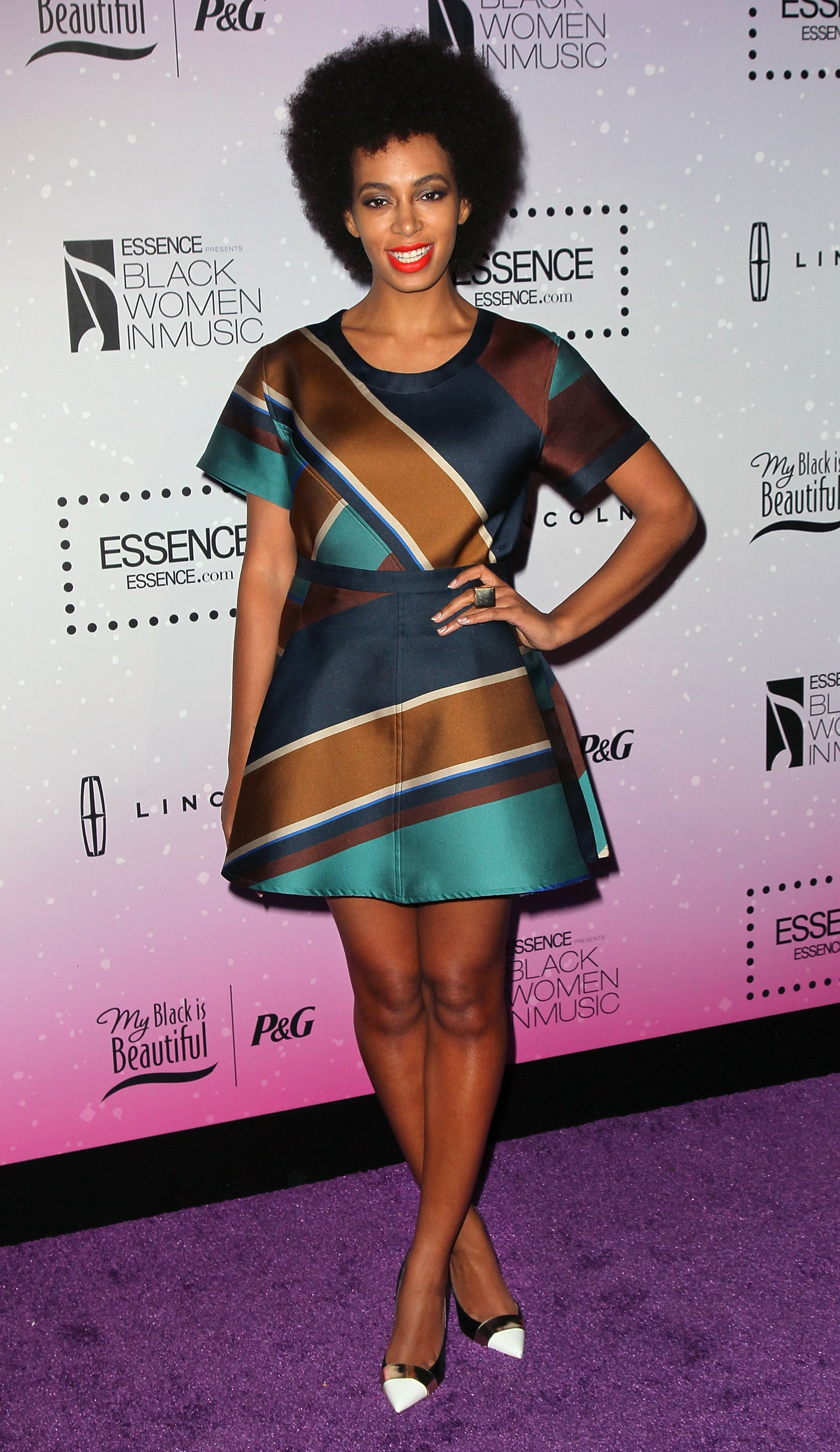 At the 2013 Essence Black Women in Music event in LA, Solange kept her love for prints going in an Ostwald Helgason minidress and Nicholas Kirkwood cap-toe pumps.