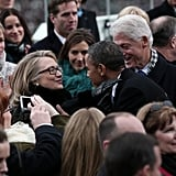 Barack Obama greeted Hillary and Bill Clinton.