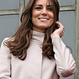 Kate Middleton donned a cream-colored jacket with a belt.
