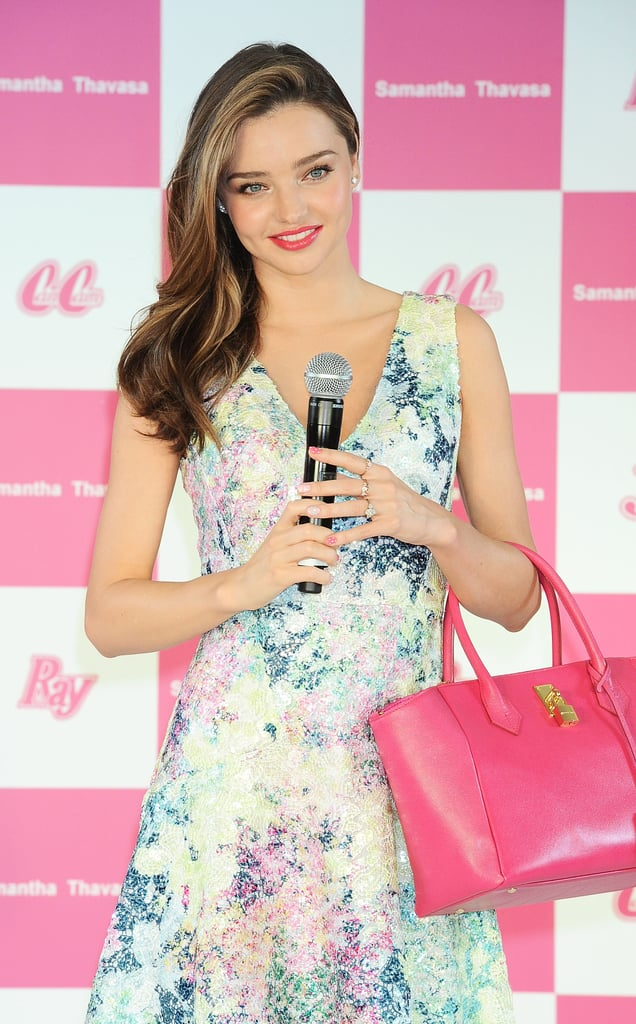 Miranda Kerr wore a beautiful printed dress with pink bag.