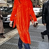 Making a bold statement in an electrifying orange trench coat in NYC in December 2005.