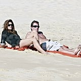 Cindy Crawford and shirtless Rande Gerber reclined on the beach.