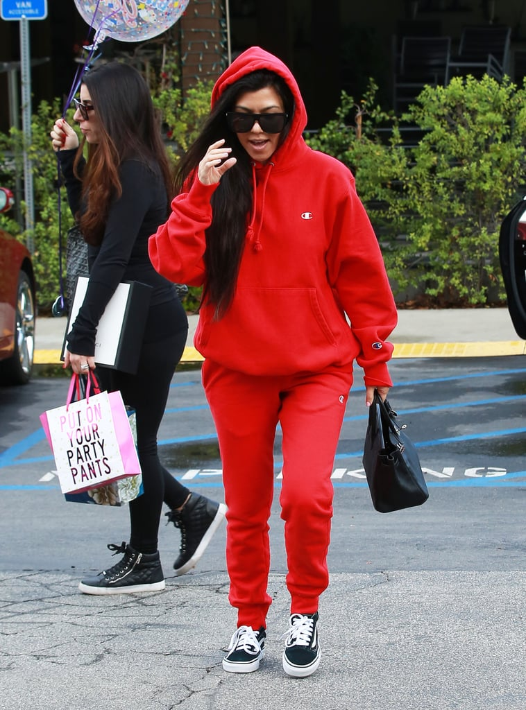Kourtney's cherry-red sweatsuit is from Champion's collaboration with Urban Outfitters.