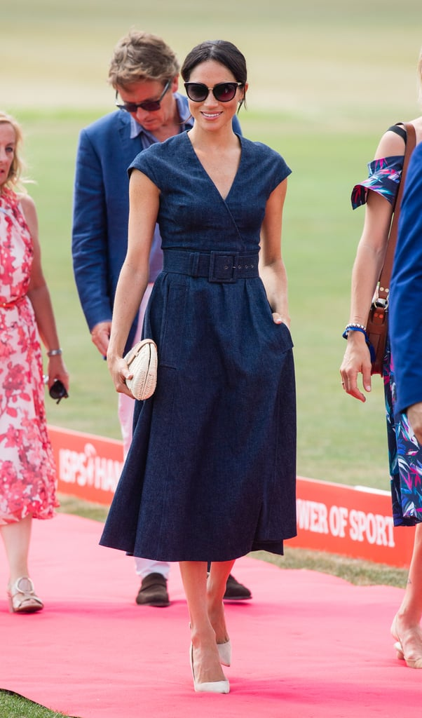 Meghan's denim Carolina Herrera dress, belted at the waist, made quite the statement at the 2018 Sentebale Polo. She styled the design with a J.Crew clutch, Aquazzura heels, and Tom Ford sunglasses.