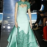 Gigi's Last Moschino Look Was a Turquoise Gown That Swept the Runway