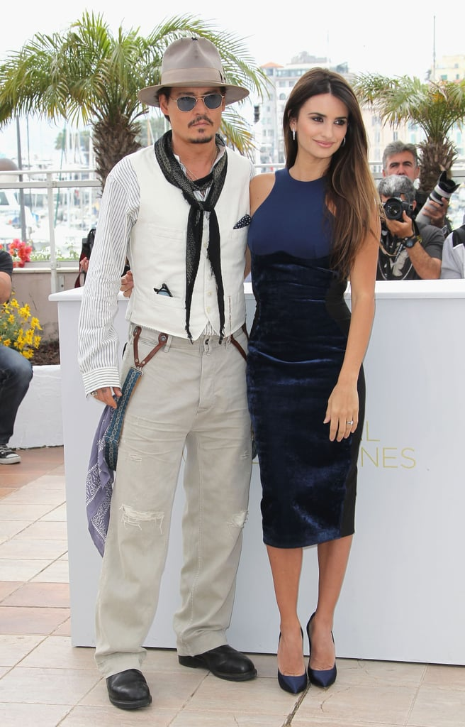 """Penelope Cruz looked phenomenal in her curve-hugging Stella McCartney dress and Johnny Depp was dapper in white at this afternoon's Cannes Film Festival Pirates of the Caribbean: On Stranger Tides photo call ahead of tonight's big premiere. The two posed for cameras alongside their costars, including cute newcomer Sam Claflin, as they headed in to take questions at a press conference. The two kept things light answering their questions, with Johnny joking that he's """"scared"""" of critics and the only reviews he pays attention to are his kids' — they've given this one raves. """"My family have seen more of my movies than I have. In fact, a lot more, including this one,"""" Johnny said, """"So they go and see the movies, and basically, I can tell by their reaction if I did all right or not. So I'm very lucky in that way. They seem to enjoy them so far. I haven't been fired by my kids.""""  He also revealed that his little ones are where he tests his material: """"They've been angels through this process, because I started out secretly testing characters on them to see how the reactions would be. When my daughter was little, we'd be playing Barbies, and I'd start doing these voices. Finally, she just said, 'Stop.'"""" In the movie, the characters are looking for the fountain of eternal youth, but in real life the stunning 37-year-old Penelope isn't afraid to age. She spoke about people's obsession with staying young: """"Birthdays are always something to celebrate. I'm looking forward to every step of the way. Maybe because I'm from Spain, that's looked at in a different way there than, for example, a place like Los Angeles . . . There are a lot of things that I keep from my roots and that's one of them, the way we look at that. I never want to be afraid of that. Change is good."""" The two were soon off to make a costume change before this evening's red-carpet gala, which is just the latest on an international press tour that has already included stops in Russia and London."""