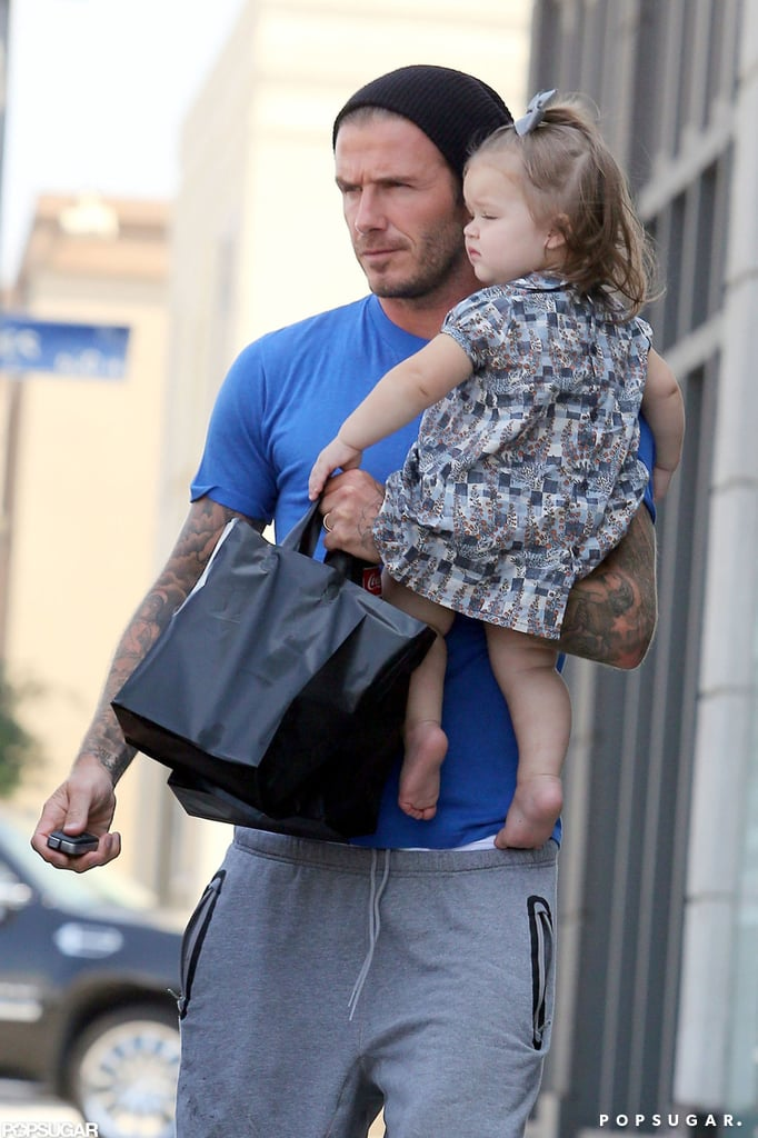 David and Harper Beckham shared a sweet father-daughter outing in LA yesterday afternoon. The duo grabbed lunch on Melrose and then headed back to their car. Harper was decked out in an adorable printed dress while David went casual in sweats. They recently wrapped up a fun family weekend that included plenty of soccer. Harper sat on the sidelines with David, who kissed her as she hung out in his lap, while her brothers took the field. The next day, David joined a dressed-down Victoria to see Brooklyn and Romeo play. Due to an injury, David didn't suit up for his own match, instead watching from the stands with his kids.