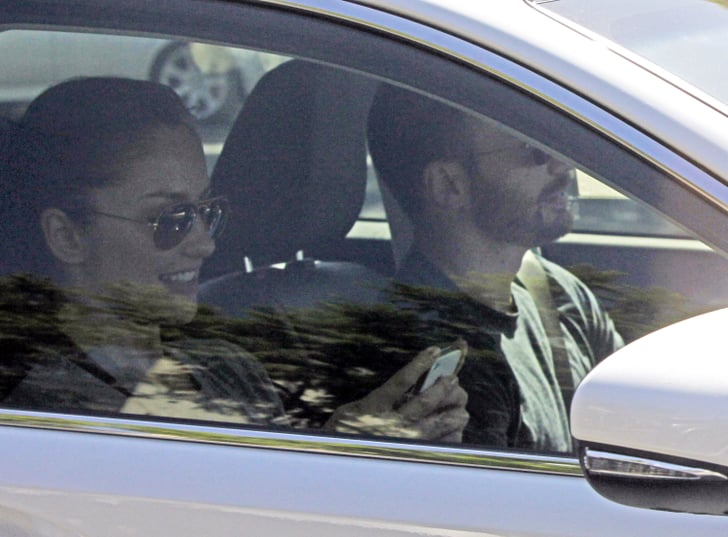 Minka Kelly couldn't contain a smile in the car with Chris Evans.