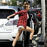 Miley Cyrus hurried into an American Apparel store in LA.