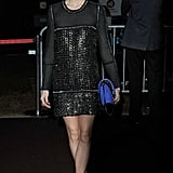 Before boarding Roberto Cavalli's yacht party in Cannes, Olivia Palermo stopped to pose for photos in a black embellished Roberto Cavalli minidress and a bright cobalt bag.