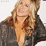 Jennifer Aniston worked her hands through her 'do at an event in LA.