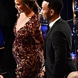 Chrissy Teigen and John Legend held hands as they walked through the audience.